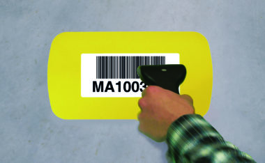 Yellow DL sized floor location label to identify areas on a warehouse floor, clear window allows barcodes to be scanned